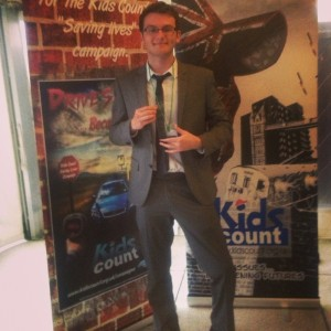 Stephen collecting Kids Count Most Inspirational Young Person 2013 Award